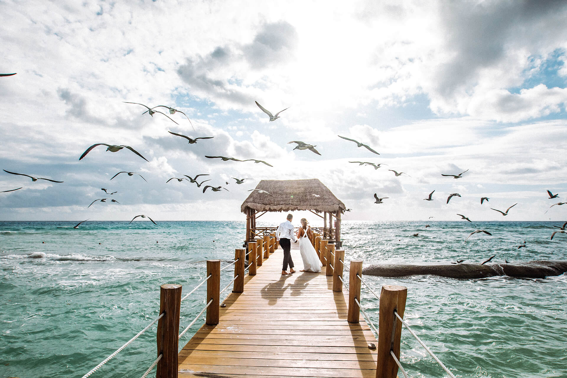 Couple getting married on a pier in Mexico