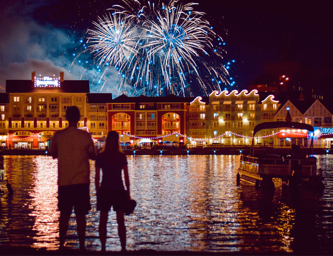 A couple watching the fireworks show at Disney's Broadway Resort